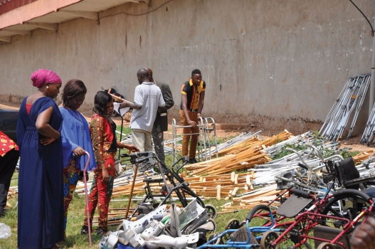 Rena Community Development Association giving out free crutches and wheelchairs at their offices in Nansana Uganda